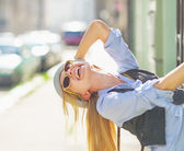 Hipster girl on city street — Stock Photo