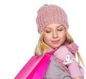 Girl in winter clothes with christmas shopping bag — Stock Photo