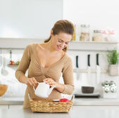 Happy young housewife serving breakfast tray — Stock Photo
