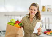 Housewife with shopping bag full of vegetables — Stock Photo
