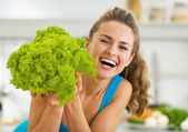 Happy young woman with fresh salad — Stock Photo