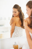 Young woman in bathroom — Stock Photo