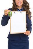Closeup on happy realtor woman with keys showing blank clipboard — Foto Stock