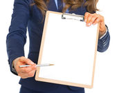 Closeup on business woman giving clipboard for sign — Stock Photo