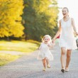 Happy mother and baby walking in city — Stock Photo