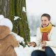 Happy mother and baby playing outdoors in winter — Stockfoto