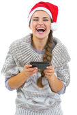 Young woman in sweater and christmas hat — Stock Photo