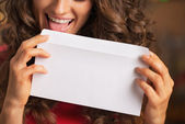 Woman licking envelope — Stock Photo
