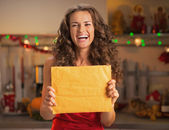 Housewife with christmas package — Stock Photo