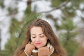 Woman in winter outdoors — Stock Photo