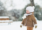 Portrait of smiling baby in winter park — Stock Photo
