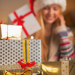Closeup on stack of christmas present boxes and teenage girl — Stock Photo #36989347