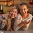 Smiling two girlfriends having christmas snacks in christmas dec — Stock Photo