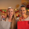 Smiling two girlfriends with shopping bag in christmas decorated — Stock Photo