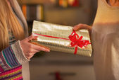 Closeup on two girlfriends exchanging christmas presents — Stock Photo