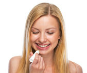 Portrait of happy teenage girl applying hygienic lipstick — Stock Photo
