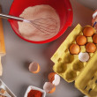 Stock Photo: Closeup on table with flavoring eggs dough whisk rolling pin