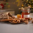 Honey and walnuts on table — Stock Photo