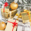 Closeup on christmas present boxes under christmas tree — Stock Photo