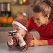 Happy mother and baby looking photos in camera — Stock Photo