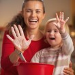 Stock Photo: Closeup on mother and baby hands smeared in flour