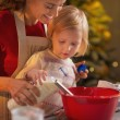 Mother and baby making christmas cookies in kitchen — Stock Photo