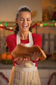 Happy young housewife throwing up dough for christmas cookies — Stock Photo