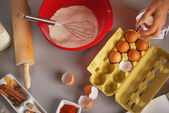 Closeup on table with flavoring eggs dough whisk rolling pin — Stock Photo