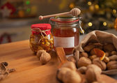 Closeup on honey and walnuts on table — Stok fotoğraf