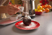 Closeup on young housewife decorating apple in chocolate glaze — Stock Photo