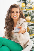 Closeup on tv remote control in hand of young woman — Stock Photo