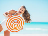 Portrait of happy young woman in swimsuit with beach hat — Stock Photo