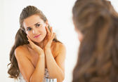 Young woman checking facial skin condition — Stock Photo