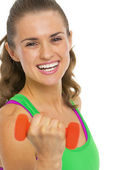 Portrait of fitness young woman with dumbbells — Stock Photo