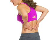 Closeup on young woman having back pain — Stock Photo