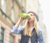 Hipster enjoying cup of hot beverage — Stock Photo