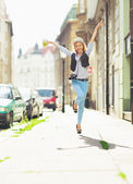 Young hipster winking in the city — Stock Photo