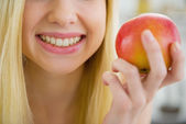 Young woman holding apple — Stock Photo