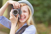 Hipster taking photo with retro camera — Stock Photo