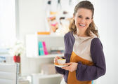 Fashion designer with coffee at work — Stock Photo