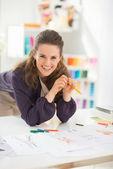 Happy fashion designer in office — Stock Photo