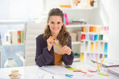 Smiling fashion designer in office — Stock Photo
