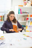 Concerned fashion designer in office — Stock Photo