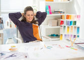 Relaxed fashion designer in office — Stock Photo