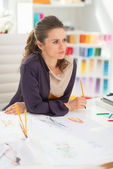 Thoughtful fashion designer in office — Stock Photo