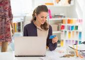 Fashion designer making online shopping — Stock Photo