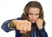 Serious business woman punching in camera — Stock Photo