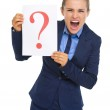 Business woman showing paper with question mark — Stock Photo