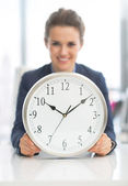 Happy business woman with clock — Stock Photo