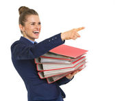 Business woman with stack of folders — Stock Photo